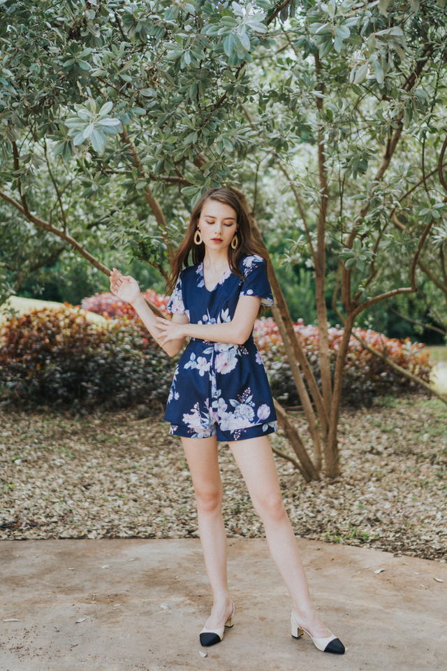 Minji Floral Printed Overlay Romper in Navy (XS)