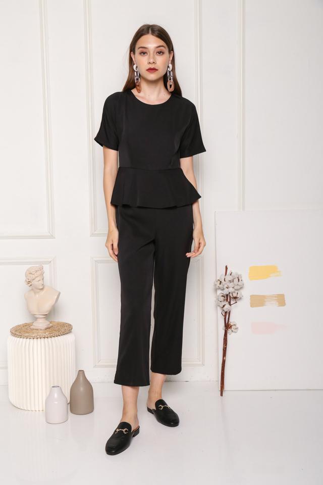 Raea Sleeved Overlay Peplum Jumpsuit in Black (XS)