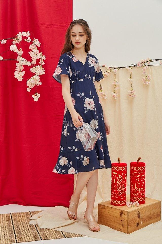 Trudy Floral Ruffled Hem Midi Dress in Navy (XS)