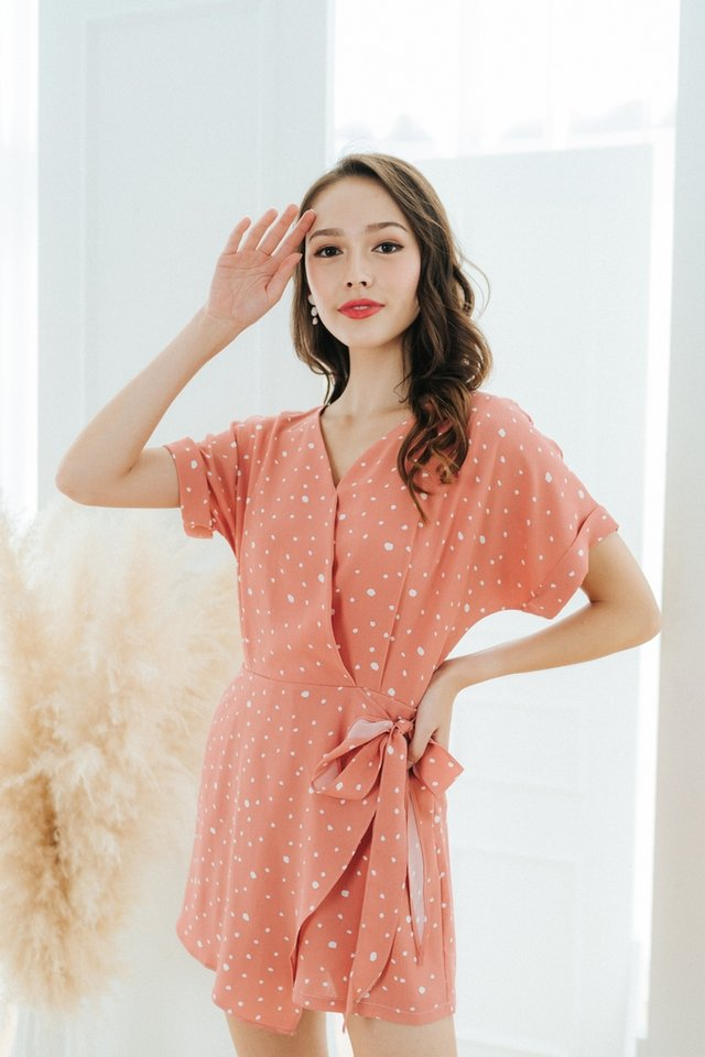 Joana Printed Faux Wrap Romper in Coral Peach